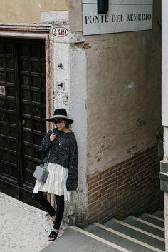 J.W.Anderson Sweater and Skirt, R13 Denim, Dear Frances Sandals, Loewe Sunglasses, Mark Cross Bag, Janessa Leone Hat in Venice, Italy via @eggcanvas