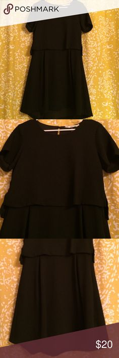 Dress Women's black dress with top overlay and has side pockets. Fabric: 100% Polyester Ellison Dresses Midi