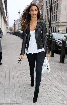 Simple but effective: Rochelle Humes worked a classic black and white outfit as she arrive...