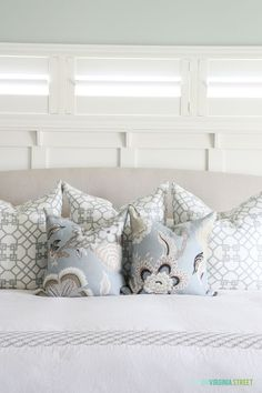 Master bedroom with Sea Salt painted walls, Schumacher Hothouse Flower pillows and Windsor Smith Pelagos shams