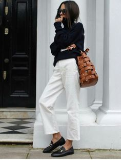 Loose ankle cropped white straight Jean black turtleneck sweater woven cognac leather bucket bag black gold loafers