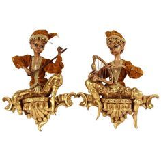 Late 19th/Early 20th Century Italian Pair of Carved Giltwood Wall Plaques Depicting Musical Figures | From a unique collection of antique and modern wall brackets at https://www.1stdibs.com/furniture/wall-decorations/wall-brackets/