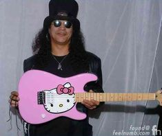 """I recently came across this really cool photo of Krist Novoselic on stage playing a pink """"Hello Kitty"""" guitar. After doing a bit of research on the guitar I found out it is a """"Hello Kitty Stratocaster"""" by Squier (Fender). Squier Guitars, Fender Squier, Hair Metal Bands, 80s Hair Bands, Music Humor, Music Memes, Guns N Roses, Saul Hudson, Hello Kitty"""