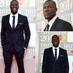 Where Do They Know Me From! British rapper #Stormzy who is nominated for 'British Breakthrough Act' poses on the red carpet at the #BRITAwards.