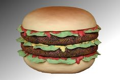 Double meat dressed hamburger is sure to cure anyone who is hungry.