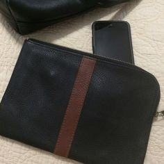 NWOT Madewell The Zip Pochette NWOT fully lined, in black and brown leather with pockets inside so you can use it as a wallet ❌ I do not trade. Please do not ask. Madewell Bags Clutches & Wristlets