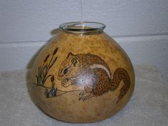 A wood-burned chipmunk that I did. You place a battery-operated light on top.