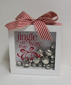 Decor - shadow box, scrapbook materials, jingle bells, and ribbon! (use acorns for Thanksgiving, candy corn for Halloween, jelly beans for Easter, etc...)