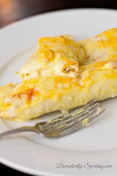 Creamy White Chicken Enchiladas - ***use fat free or reduced fat milk, sour cream and cheese for a lower cal version.***
