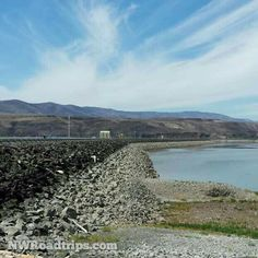 The back side of #WanapumDam on the #ColumbiaRiver.  With the #WanapumDrawdown in effect due to a crack in the #dam, a lot more of the dam is visible than normal.  Everything below the top of that white line is normally covered with water.  #GiantBathtubRing #hydroelectricdam #hydroelectricity #earthendams #CheapPower #CleanPower #SR243 #dams #DamRoadTrip #VantageWA #Wanapum #Mattawa #EasternWashington #UpperLeftUSA #NorthwestIsBest #PNWlove #RoadTrip #NWRoadtrips