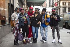 "I see a lot of this style around Astor Place/St. Marks - It's sort of 80's 90's hip hop and fun. The two girls on the left add a bit of the ""hipster""/""NYC grunge"" aspect with Doc Marten-esque boots. This represents the hip hop and music-drawn part of New York City to me, I think it would be interesting to see this style revive a bit in high fashion with certain designers."