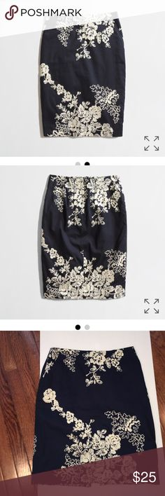 """J Crew cotton skirt Some pieces look good on everyone,this skirt is one of those. Navy blue with white floral embroidery.Cotton,2 side pockets,lined,back vent,back zip.Sits at waist,21.5"""" long.Great pre-owned condition. J. Crew Skirts Midi"""