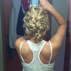"SO easy to create this style: Curl hair with 1"" curling iron, loosely french braid it, then take the bottom of the braid and twirl it into a bun and bobby pin!"