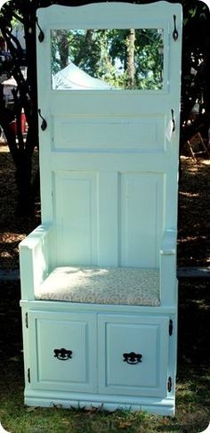 "Look at what you can make with a door, a cabinet, and some hooks.  You could find a 30"" wide door and 30"" wide cabinet at a home improvement store, attach them, trim them with baseboard, then prime and paint them both.   The mirror and cushioned seat are an added bonus.  What a marvelous hall tree for a foyer or narrow wall space.  This is another fabulous DIY project."