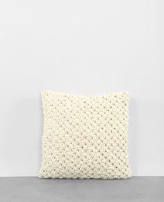 Housse de coussin tricotée
