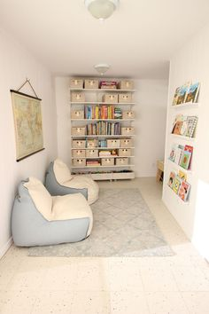 Kids reading a game nook. Click through to see the other part of the playroom with art, science, and writing centers. -The Art Pantry