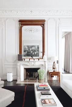 living room | mantle mirror | crown moulding | Paris Apartment | Modern Style | French Interiors | Home Design
