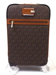 4e208054a647 NEW MICHAEL KORS SIGNATURE BROWN PVC TRAVEL TROLLEY ROLLING CARRY ON  SUITCASE #travel #destinations #bucketlist #tips #words #hacks #quotes # europe #ideas ...