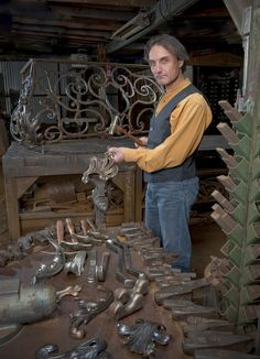 Jean-Pierre Masbanji is a third generation metal smith and a accomplished repouss'er. Shown here with a nice assortment of top tools for forgework and on the table top his repousse hammers and stakes laying with some fine acanthus foliage.