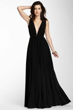 A dramatic gown perfect for anytime you need to amp up from cocktail to formal wear. This neckline is amazing!