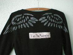 www.etsy.com/listing/214142144/medium-i-am-the-mockingjay-long-sleeve-shirt