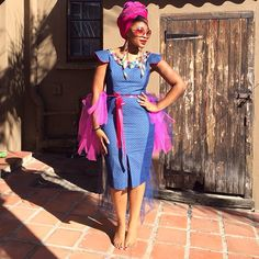 Shweshwe/Sotho Tradition with a tulle enhancement.