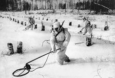 Red Army sappers are using induction mine detectors type VIM-203 to clear German minefield in 1942. Note the polar kits worn by the Russians - kits that the Germans never had