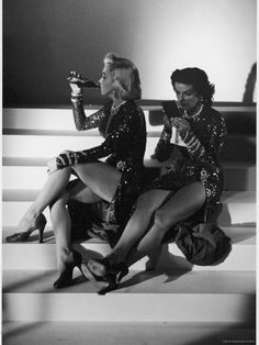 On the set of Gentlemen Prefer Blond...Jane Russel and Marilyn Monroe. Two sets of gorgeous legs!