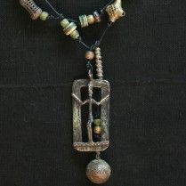 Rare Dogon bronze amulet, basketweave bronze beads from Ghana, Mongolian bone and bronze beads, bell from Rajasthan. 46″ Lariats are leather cords, which can be tied once around the neck, left loose to complement a scarf or wrapped twice to create a short choker. Let your creativity find other ways to wear them.