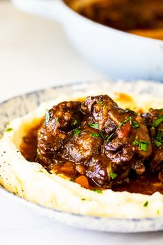 Slow Braised Oxtail - Simply Delicious Slow braised oxtail cooked in a delicious, rich sauce is pull-apart tender, unctuous and perfect served on a bed of creamy mashed potatoes. Oxtail Recipes, Meat Recipes, Cooking Recipes, Dinner Recipes, Curry Recipes, Beef Recepies, Sunday Recipes, Fall Recipes, Dinner Ideas