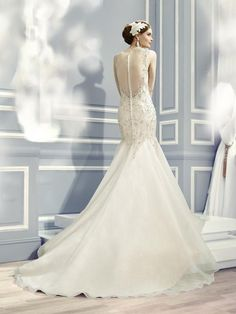 Moonlight Couture H1285 romantic lace wedding dresses with sleeves and beading make a statement.