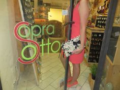 SoSo Vogue clutch and our shop in San Gimignano