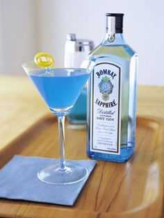 Patriotic Drinks We Love: Blue Independence  Bombay Sapphire Gin, lime juice, Blue Curaçao, and peach schnapps.