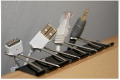 Use office clamps, clamped to the side of your desk to organise cables.