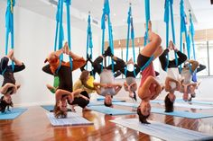 Sign up for an aerial yoga class.