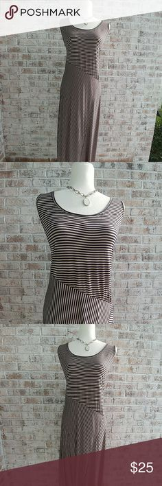 Magic Maxi Dress NWOT Navy and Tan Striped Racerback Maxi Dress. 20in from Armpit to Armpit 55in from Shoulder to Hem. 48% Rayon 48% Polyester 4% Spandex. So Relaxed and Comfortable, yet Could be Worn to the Office. Pull it on and Go! So Cute! Magic Dresses Maxi