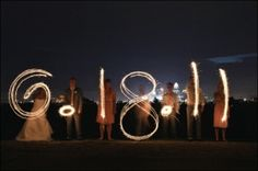 Wedding Date with sparklers. Wedding party photo - if we are able to figure this out... by delores