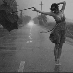 Dancing in the rain. Also having an umbrella. They're both fun. by Wito Zambrotti - Audiotool