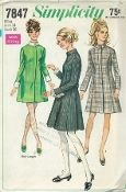 An unused original ca. 1968 Simplicity Pattern 7847.  Misses' Dress in Two Lengths: The princess line dress with concealed zipper closing in center front pleat has buttoned stand up collar, long set in sleeves fitted to button trimmed cuffs and back buttoned belt.