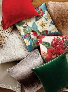 Bring the bright colors of the garden indoors. This unique, linen and velvet pillow cover features artful bead arrangements and embroidery, displaying brilliant cardinals perched on amaryllis flowers.