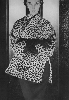 Harper's Bazaar, September 1953    Wearing a Leopard coat, sharply tailored to look like a Chionese  jacket, byReiss and Fabrizio.