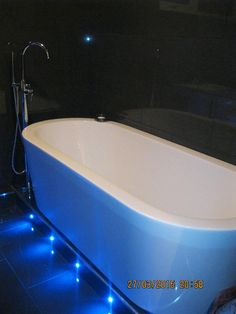 Aidan from Durham uses dark tiles against the white Arc Freestanding Bath from VictoriaPlumb.com and has installed custom blue L.E.D lights for a super-cool glow. #VPShareYourStyle
