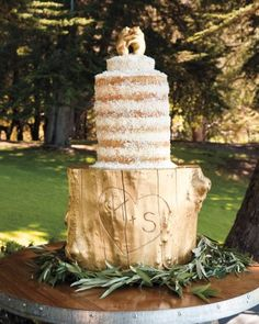 "The cream cheese–frosted coconut cake was topped by dancing bears—the first thing Sarah bought for the wedding—that the baker gilded with 18-karat gold leaf. It was placed on a ""cake stand"" (now a side table in the newlyweds' home) that the baker's boyfriend fashioned from a fallen Monterey Pine."