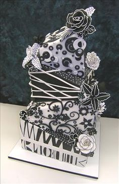 I like the idea...but i think theres just wayyyyy too much going on for this cake!    colette's cakes | decorative cakes for all occasions