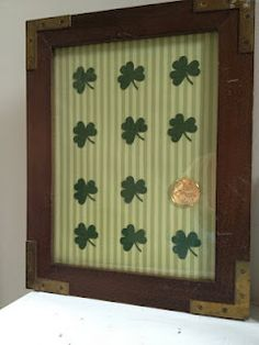 Thats cute.  I'm sure I could find shamrock stickers, put on paper, add gold coin and use 1$ store frames.  You could use a number of different frame sizes