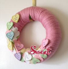 I have tons of yarn and felt. What an adorable inspiration for a wreath.