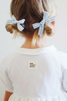 This blue stripe hand-tied bow pigtail set is here just in time for your next summer adventure. // Free Babes Handmade X Briar Handmade Blue Stripe Pigtail Set. The perfect hair bow for your baby, toddler or little girl's free spirited style.
