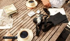 four favorites: coffee, camera, wood bench and man-hands.