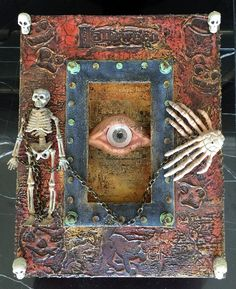 I had alot of fun creating this mixed media Halloween frame using a Tando Creative dimensional frame and some miscellaneous Halloween pieces I get from a local craft store.  The eye in the center was created using Paper Clay and paint brush bristles.  You can find a complete pictorial tutorial on my blog here: http://candycreates.blogspot.com/2017/05/halloween-fun-with-andy-skinner-and.html