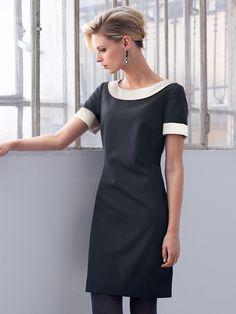 Klänning från Uta Raasch med halvlång ärm. Lätt utställd modell som lyfter  siluetten genom breda 455eee774fa7f